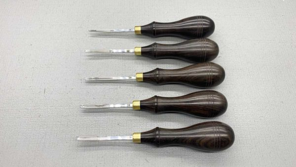 Five Leather Edgers With Ebony Handles